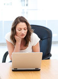 Thoughtful businesswoman working on laptop Royalty Free Stock Photo