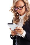 Thoughtful businesswoman working with tablet Stock Images