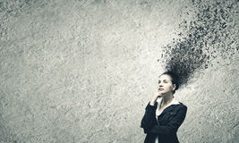 Thoughtful businesswoman. Young troubled businesswoman thinking over the ideas Stock Images
