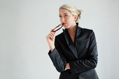 Thoughtful businesswomen. Available light shot Royalty Free Stock Image