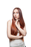 Thoughtful casual red-haired female on white Royalty Free Stock Photos