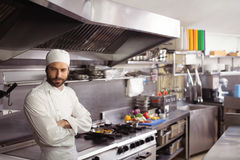 Thoughtful chef standing in commercial kitchen. At restaurant royalty free stock photography