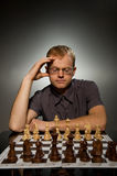 Thoughtful chess master Royalty Free Stock Photos