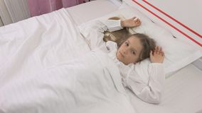 Thoughtful Child in Bed, Meditative Kid, Girl Can`t Sleeping in Bedroom stock photos