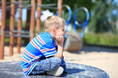 Thoughtful child boy or kid on playground Royalty Free Stock Image