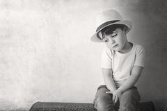 Thoughtful child with hat Stock Photos