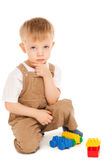 Thoughtful child playing with toys isolated Royalty Free Stock Photos