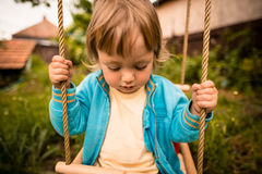 Thoughtful child on seesaw Stock Photos