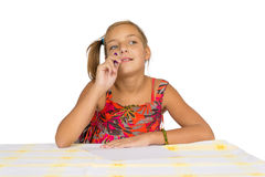 Thoughtful child write letter Stock Photography
