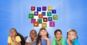 Thoughtful children against application icons royalty free stock images