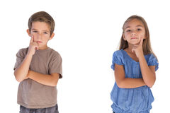 Thoughtful children standing with arms crossed stock photos