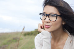 Thoughtful Chinese Asian Woman Girl Wearing Glasses Royalty Free Stock Images