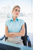 Thoughtful classy businesswoman crossing arms Royalty Free Stock Photo