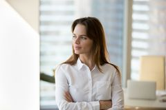 Thoughtful confident successful businesswoman looking away think royalty free stock image