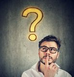 Confused handsome man has a question and no answer Royalty Free Stock Photos