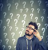 Thoughtful confused man has too many questions and no answer Stock Photos