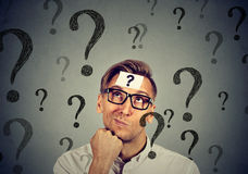 Thoughtful confused man has many questions no answer Stock Photo