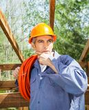 Thoughtful Construction Worker With Hand On Chin Stock Photo