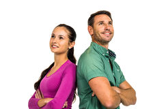 Thoughtful couple standing back to back looking away Stock Photography
