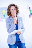 Thoughtful creative businesswoman looking away Stock Images
