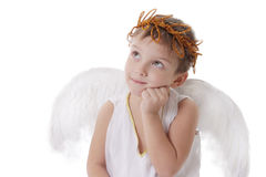 Thoughtful cupid boy with wings and graland Stock Image