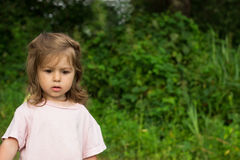 Thoughtful cute little girl green background Stock Photography