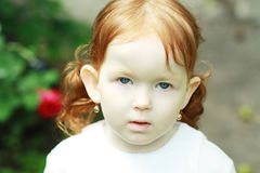 Thoughtful cute little girl Royalty Free Stock Images