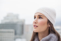 Thoughtful cute woman with winter clothes on posing Stock Photography