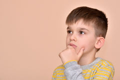 Thoughtful cute young boy Stock Photography