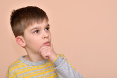 Thoughtful cute young boy Royalty Free Stock Photo