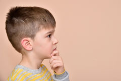 Thoughtful cute young boy Royalty Free Stock Photography