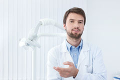 Thoughtful dentist Royalty Free Stock Photo