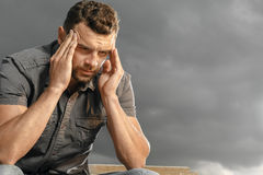 Thoughtful, depressed, handsome man Stock Photos