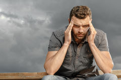 Thoughtful, depressed, handsome man Royalty Free Stock Photos
