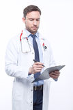 Thoughtful doctor holding papers Royalty Free Stock Image