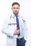 Thoughtful doctor holding papers Royalty Free Stock Images