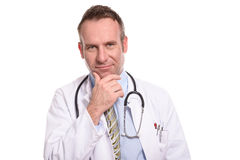 Thoughtful doctor looking at the camera Stock Image