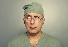 Thoughtful doctor looking up Royalty Free Stock Image