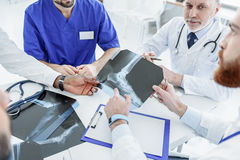 Thoughtful doctors having meeting in hospital Stock Photos