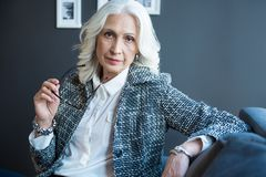 Free Thoughtful Elder Woman Is Expressing Confidence Royalty Free Stock Images - 103188619
