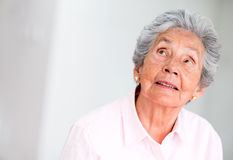 Thoughtful elder woman Royalty Free Stock Image