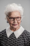 Thoughtful elderly lady looking at camera Royalty Free Stock Images