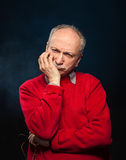 Thoughtful elderly man Stock Images