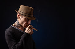 Thoughtful elderly man with  cigar Royalty Free Stock Photos
