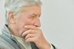 Thoughtful elderly man Royalty Free Stock Image