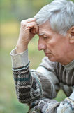 Thoughtful elderly man Stock Photography