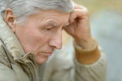 Thoughtful elderly man stock photo