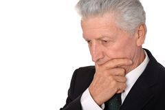 Thoughtful elderly man in suit Stock Photos