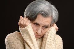 Thoughtful elderly woman Stock Photo