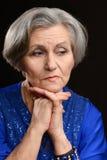 Thoughtful elderly woman Stock Photos